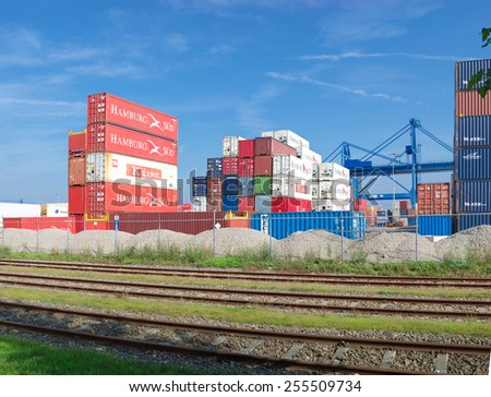 ROTTERDAM - OCTOBER 4, 2014: Piled up cargo containers in the rotterdam port. It is the largest port in Europe, covering 105 square kilometers (41 sq miles) - stock photo