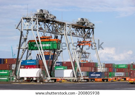 ROTTERDAM - SEP 8: Container terminal and cranes on Sep 8, 2012 in Rotterdam, Netherlands. The port is the largest in Europe and facilitate the needs of a hinterland with 40,000,000 consumers.  - stock photo