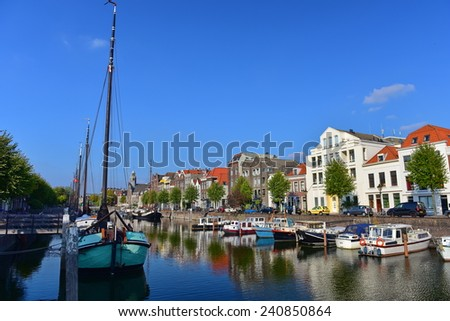 ROTTERDAM - SEPTEMBER 18: Houses and boats along river Nieuwe Maas at Delfshaven, taken on September 18, 2014 in Rotterdam, Netherlands - stock photo