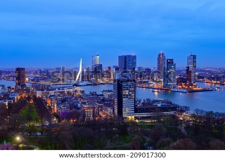 Rotterdam skyline at twilight as seen from the Euromast tower, The Netherlands - stock photo