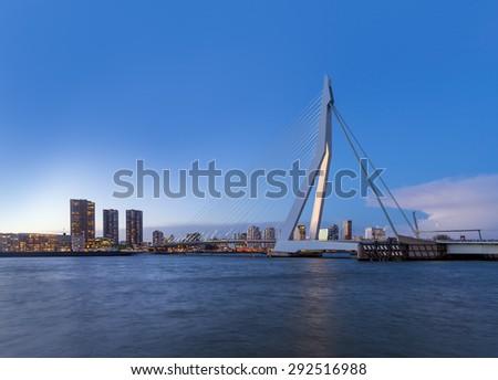 Rotterdam Skyline with Erasmus Bridge at Dusk, The Netherlands - stock photo