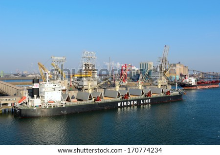 ROTTERDAM, SOUTH HOLLAND, NETHERLANDS - MARCH 28: Ships being loaded and unloaded in the Port of Rotterdam on March 28, 2013 in Rotterdam, South Holland, Netherlands.