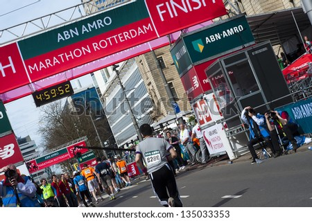 ROTTERDAM, THE NETHERLANDS - APRIL 14 : Annual Fortis Rotterdam Marathon. Runners on the city streets on April 14, 2013 in Rotterdam, The Netherlands.