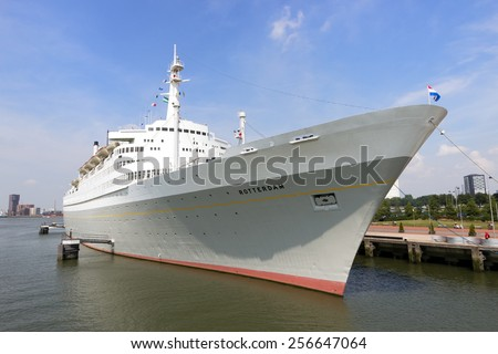 ROTTERDAM, THE NETHERLANDS - AUG 1, 2014: The SS Rotterdam is a 228-meter, 13-deck former flagship of the Holland-America line features a restaurant, theater, meeting rooms, and a hotel. - stock photo