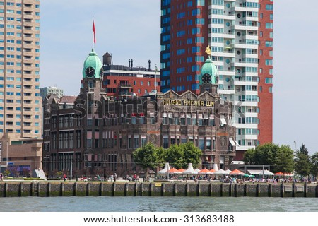 ROTTERDAM, THE NETHERLANDS - AUGUST 9, 2015: Hotel New York, the former office building of the Holland America Lines in Kop van Zuid in Rotterdam, South Holland, - stock photo