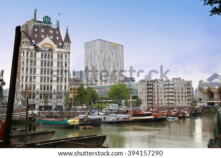 ROTTERDAM, THE NETHERLANDS - 18 AUGUST: Rotterdam is a city modern architecture, Westermeijer Tower and Oude Haven oldest part of the harbour in Rotterdam, Netherlands on August 18,2015. - stock photo