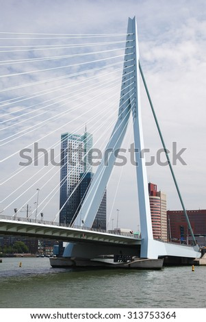 ROTTERDAM, THE NETHERLANDS - AUGUST 9, 2015: View on the city center and the Erasmus Bridge in Rotterdam, South Holland, The Netherlands. - stock photo