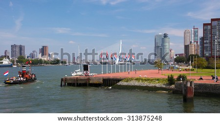 ROTTERDAM, THE NETHERLANDS - AUGUST 9, 2015: View on the city center and the Kop van Zuid neighborhood in Rotterdam, by the Nieuwe Maas in South Holland, The Netherlands.