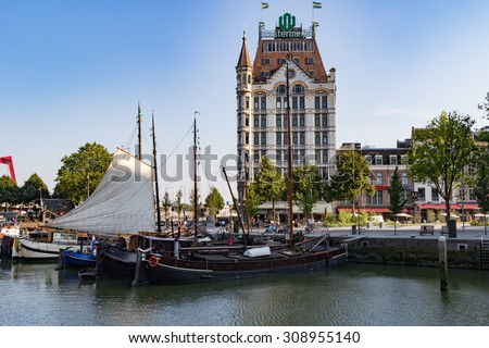 ROTTERDAM, THE NETHERLANDS - AUGUST 22 2015: Westermeijer Tower and 'Oude Haven' on a sunny evening. - stock photo