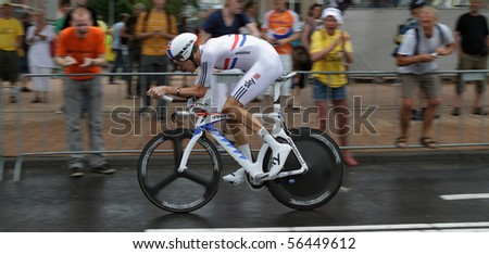 ROTTERDAM, THE NETHERLANDS - JULY 3: Bradley Wiggins participates in the 2010 Tour de France prologue time trial. July 3, 2010 in Rotterdam, The Netherlands - stock photo