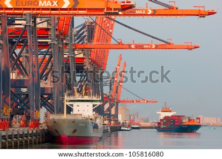ROTTERDAM, THE NETHERLANDS - JUNE 19 : Bulk carriers are supplying raw ore-deposits to the harbor of Rotterdam, the Netherlands on June 19, 2012. - stock photo