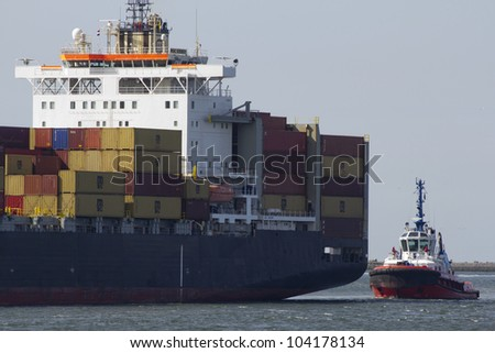 ROTTERDAM, THE NETHERLANDS - JUNE 2: Close-up of a containership, operated by a privately-owned company (MSC) engaged in worldwide container transport in Rotterdam on June 2, 2012