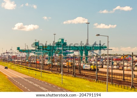 ROTTERDAM, THE NETHERLANDS - JUNE 30, 2014: View at the largest container terminal in Rotterdam harbor, The Netherlands - stock photo