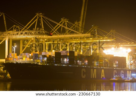 ROTTERDAM, THE NETHERLANDS - MARCH 15: Close-up of a containership, operated by a privately-owned company (CMA CGM) engaged in worldwide container transport in Rotterdam on March 15, 2012 - stock photo