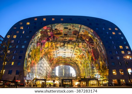 ROTTERDAM, THE NETHERLANDS - MARCH 7, 2016: Exterior night view of the new and colored Market Hall, located in the Blaak district in Rotterdam, - stock photo