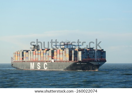 ROTTERDAM, THE NETHERLANDS - MARCH 3 2015: The MSC Oscar container ship enters the Port of Rotterdam for the first time. The largest container ship in the world at the time of photographing. - stock photo