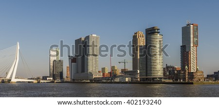 Rotterdam, The Netherlands - March 1, 2016: Wilhelminapier with skycrapers, offices, Erasmus Bridge and Hotel New York.