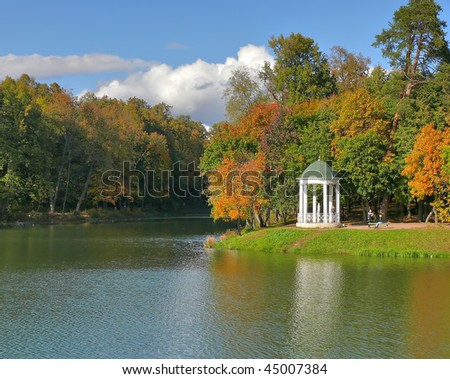 Rotunda near to water in autumn trees