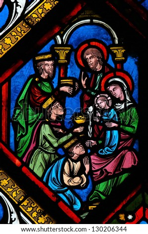 ROUEN - FEBRUARY 10: Stained glass depicting the three kings from the East who visit the Holy Family in Bethlehem,  in the cathedral of Rouen, France, on February 10, 2013. - stock photo