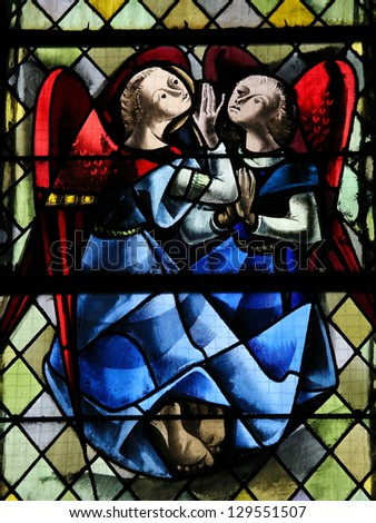 ROUEN - FEBRUARY 10: Two angels on a stained glass in the cathedral of Rouen, France, on February 10, 2013.