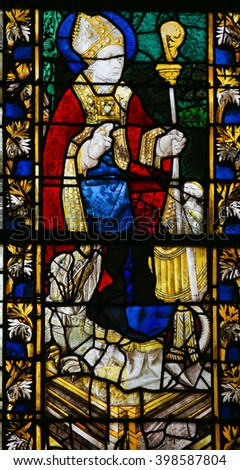 ROUEN, FRANCE - FEBRUARY 10, 2013: Saint Nicolas on a stained glass in the cathedral of Rouen, France - stock photo