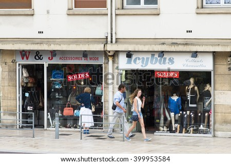 ROUEN, FRANCE - JULY 2, 2015: A couple strolls down one of the shopping streets of the French city.