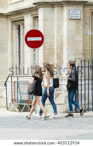 ROUEN, FRANCE - JULY 2, 2015: People walking through the shopping district, in one of the streets of the old town. - stock photo