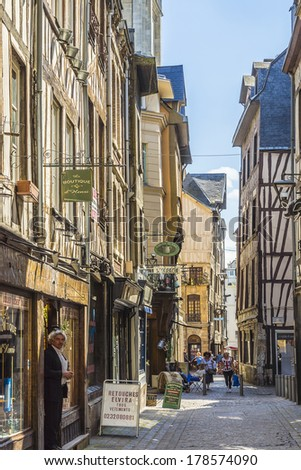 ROUEN, FRANCE - JULY 17, 2012: Wonderful views of streets in old Rouen. Rouen in northern France on River Seine - capital of Upper Normandy region and historic capital city of Normandy. - stock photo