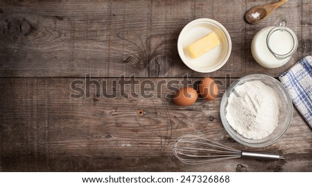 rough background with the ingredients for a cake (butter, egg, milk , flour) - stock photo