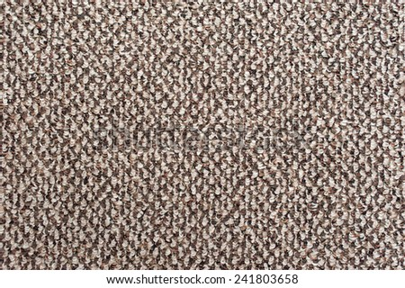 Rough brown camel wool fabric texture taken closeup as background. - stock photo