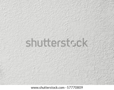 rough cement wall of house - stock photo