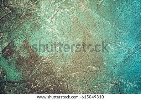 Rough concrete background in dark and light blues, textured, toned