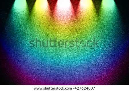 rough concrete wall with colorful spotlight