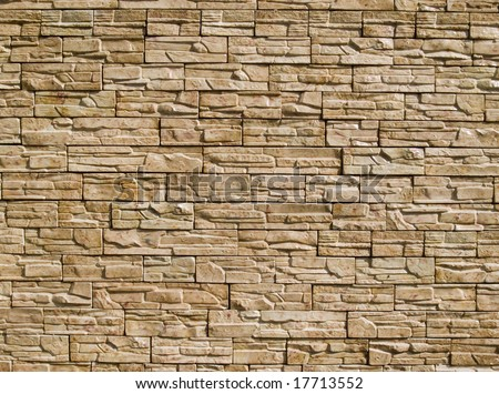 Rough decorative stone wall for a background - stock photo