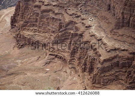 Rough  desert landscape with stones and weathered  trees - stock photo