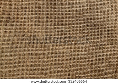 Rough hessian or burlap material as an abstract background texture - stock photo