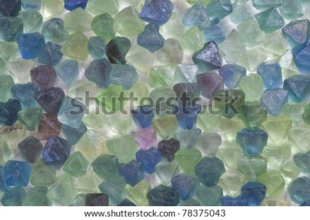 Rough octahedral  fluorite crystals, lit from behind. - stock photo