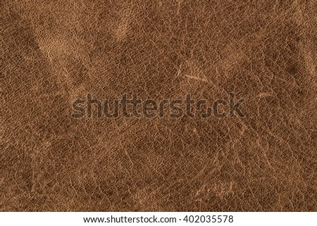 Rough old brown leather background. - stock photo