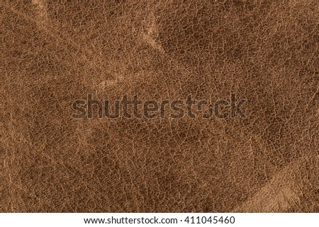Rough old brown leather background.