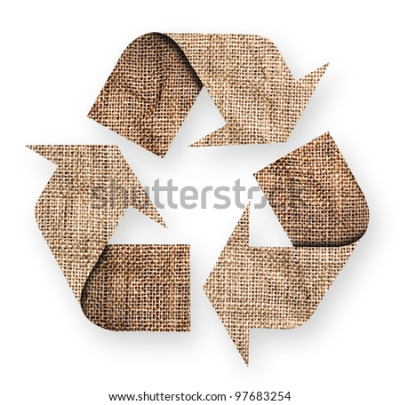 Rough old canvas with green recycle sign. - stock photo
