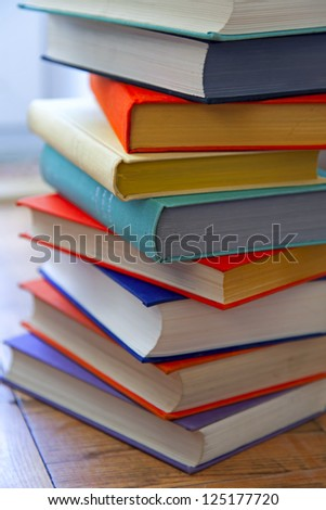 Rough pile of books in covers of various colors