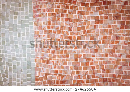 rough red mosaic tile wall in bathroom