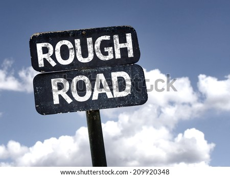 Rough Road sign with clouds and sky background  - stock photo