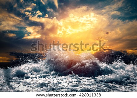 rough sea at sunset - stock photo