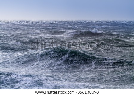 Rough sea on a sunny day at Portland Bill, England - stock photo