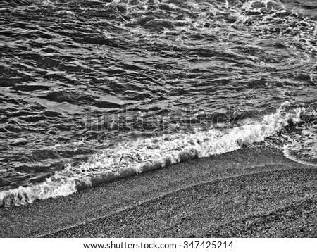 Rough sea waters along a coastline - stock photo