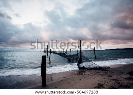 Rough sea with fish reef, dramatic sky