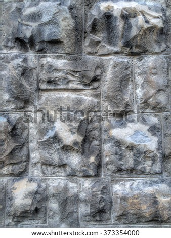 Rough stones wall of cobblestone road texture