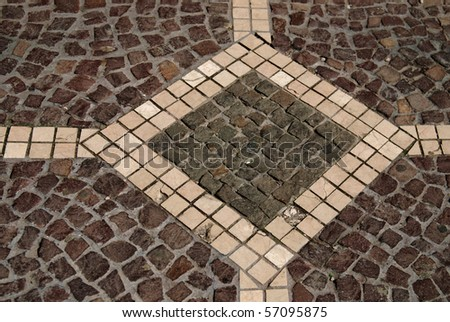 Rough texture of wet block old pavement - stock photo