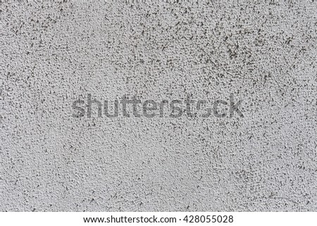 Rough texture of white painted wall. Plaster or whitewash on the wall or ceiling of the house. Rough paint on the wall structure. - stock photo